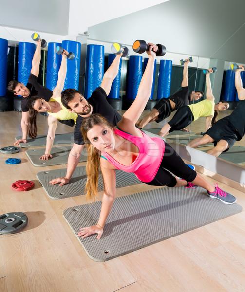 Dumbbell push up group functional training at gym Stock photo © lunamarina