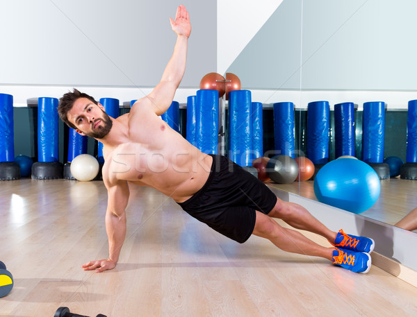 Fitness side push ups man pushup at gym Stock photo © lunamarina