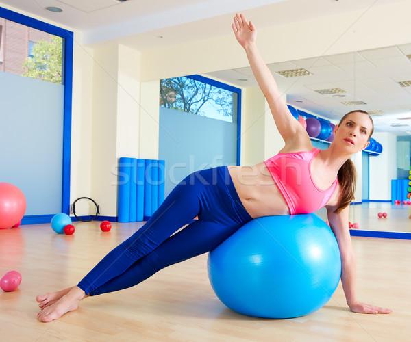 Pilates femme côté exercice entraînement Photo stock © lunamarina