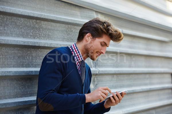 Young businessman texting smartphone phone Stock photo © lunamarina