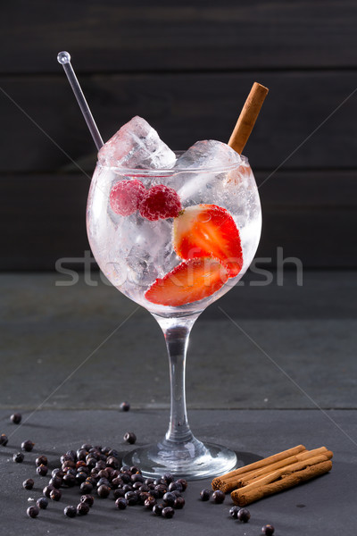 Gin tonic cocktail with strawberries cinnamon and juniper Stock photo © lunamarina