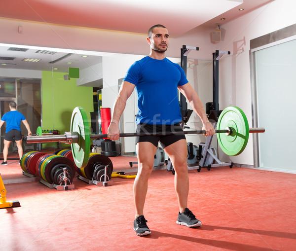 Crossfit fitness gym weight lifting bar man workout Stock photo © lunamarina