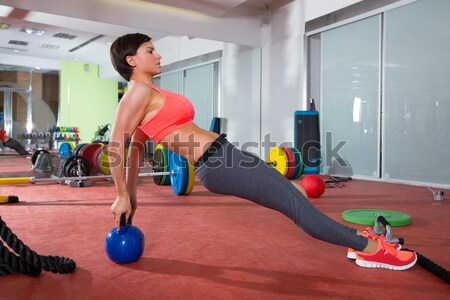 Crossfit fitness gym weight lifting bar group Stock photo © lunamarina