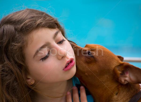 Brunette kid girl and dog pet whispering ear Stock photo © lunamarina