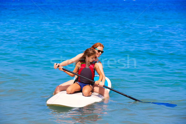 Kid поиск Surfer девушки пляж Сток-фото © lunamarina