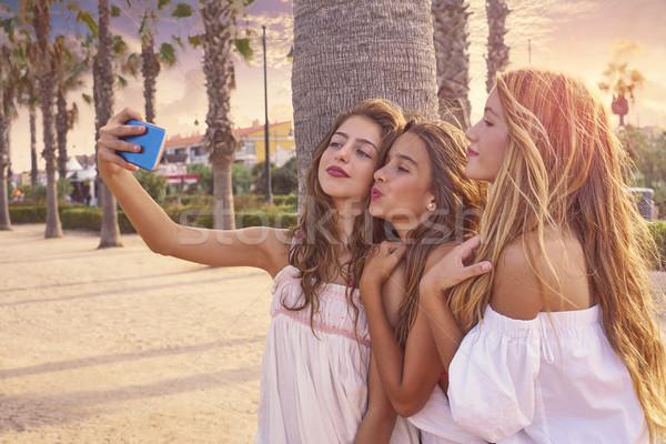 Teen best friends girls group shooting selfie Stock photo © lunamarina
