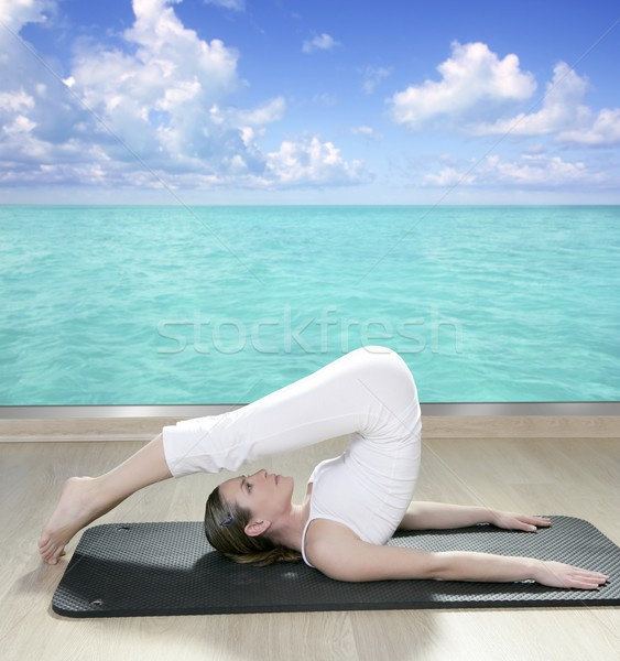 black mat yoga woman window turquoise sea view Stock photo © lunamarina