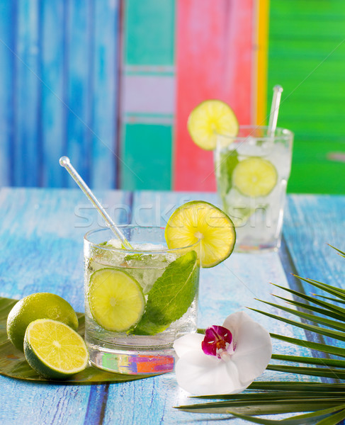 Cuban Mojito cocktail in tropical blue wood flowers and starfish Stock photo © lunamarina