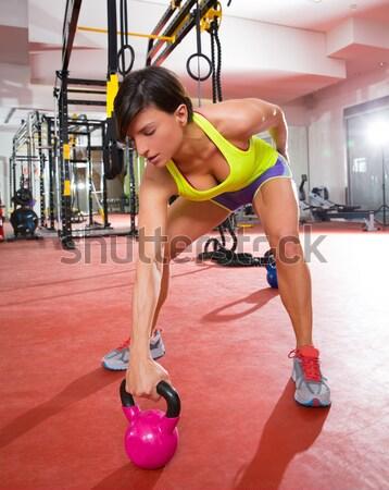 Crossfit fitness woman standing at gym holding trx Stock photo © lunamarina