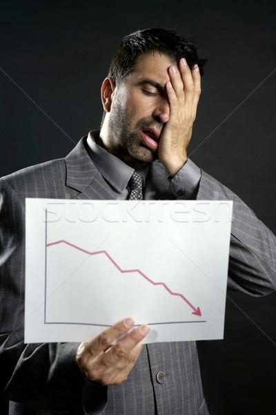 Businessman with bad sales reports chart Stock photo © lunamarina