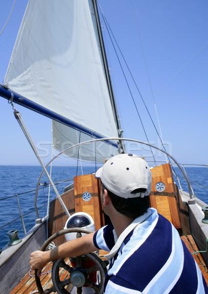 Sailor sailing in the sea. Sailboat over blue Stock photo © lunamarina