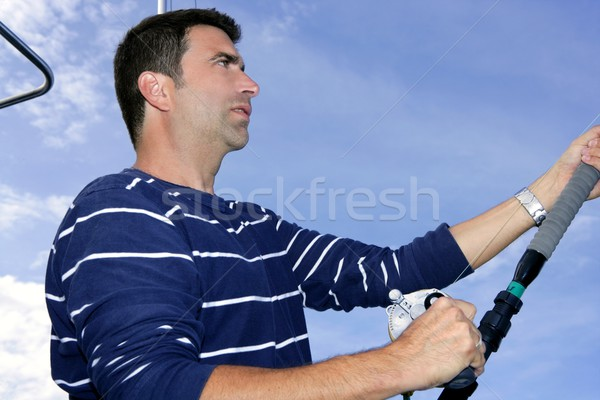 Angler fisherman trolling rod and reel fishing Stock photo © lunamarina