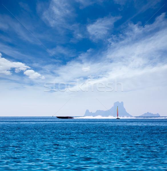 Es Vedra Ibiza silhouette with boats Formentera view Stock photo © lunamarina