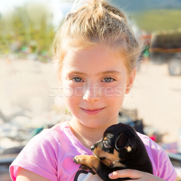 Stock photo: Blond kid girl playing with puppy dog smiling