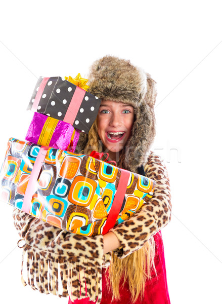 Blond winter kid girl with stacked presents smiling Stock photo © lunamarina