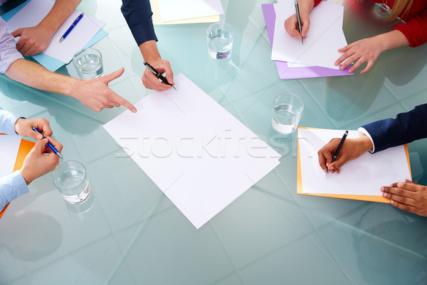 Business meeting teamwork aerial hands papers Stock photo © lunamarina