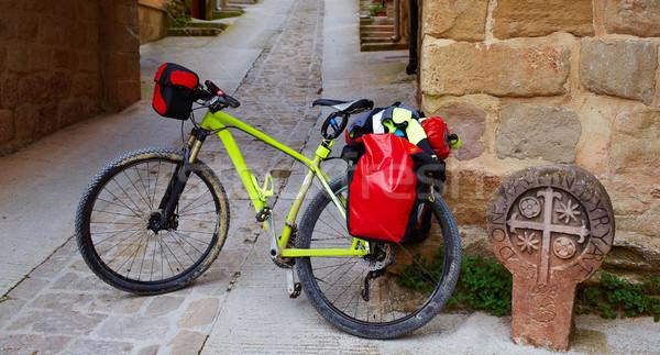 Biking Way of Saint James stone sign in Cirauqui Stock photo © lunamarina