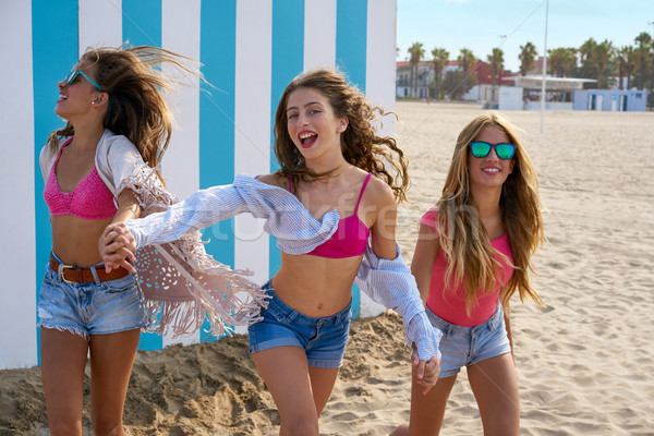 Best friends teen girls running happy in beach Stock photo © lunamarina