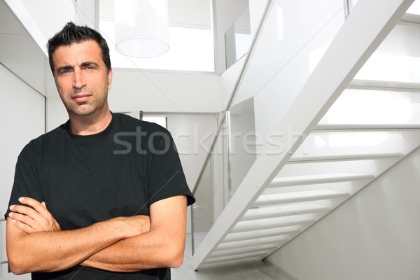 Stock photo: Modern white house lobby medium age man