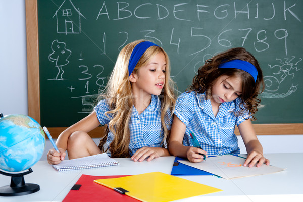 classroom with two kids students cheating on test Stock photo © lunamarina