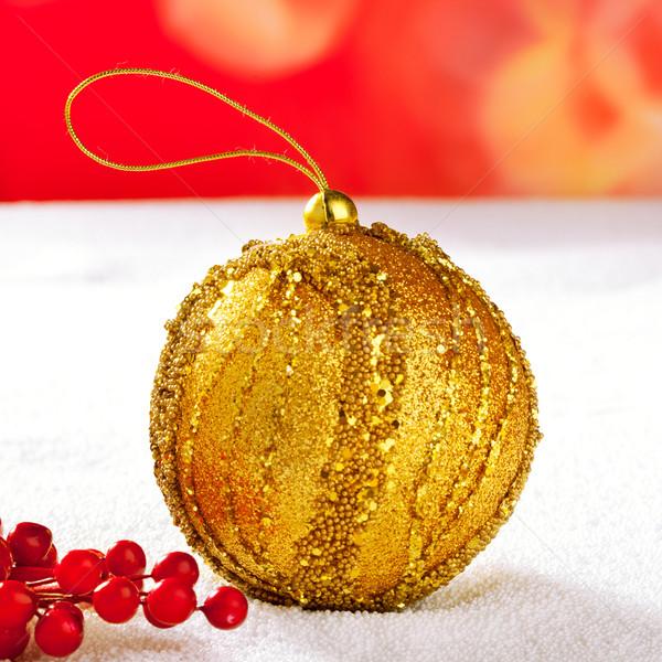 Christmas card of golden bauble berries on snow Stock photo © lunamarina