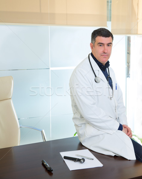 Doctor man expertise portrait casual sitting in hospital office Stock photo © lunamarina