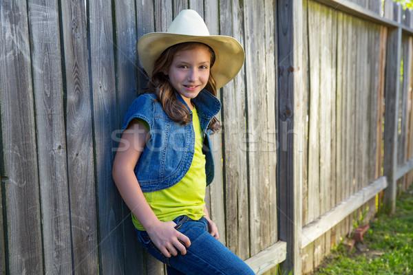 Children girl as kid cowgirl posing on wooden fence Stock photo © lunamarina