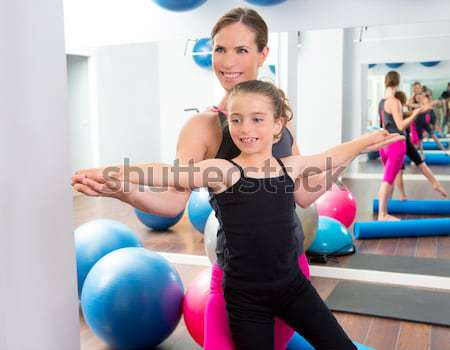 mirror pilates gym woman toning balls sport gym Stock photo © lunamarina