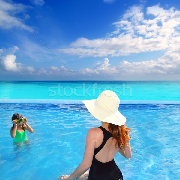 Stock photo: blue swimming pool caribbean view mother daughter