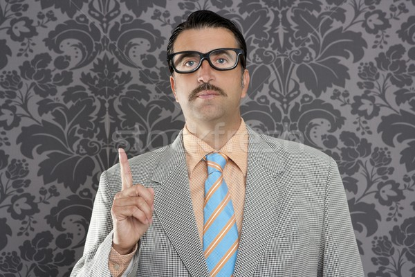 nerd retro businessman raising finger up hand gesture Stock photo © lunamarina
