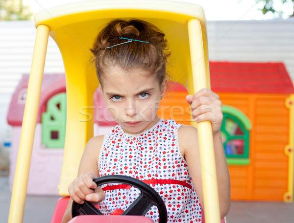 Angry toy car driver children girl Stock photo © lunamarina