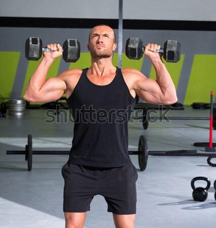 Tornaterem csoport súlyemelés bár crossfit edzés Stock fotó © lunamarina