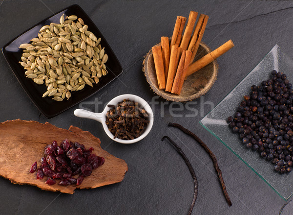 cloves cardamom cinnamon vanilla juniper berries and cranberries Stock photo © lunamarina