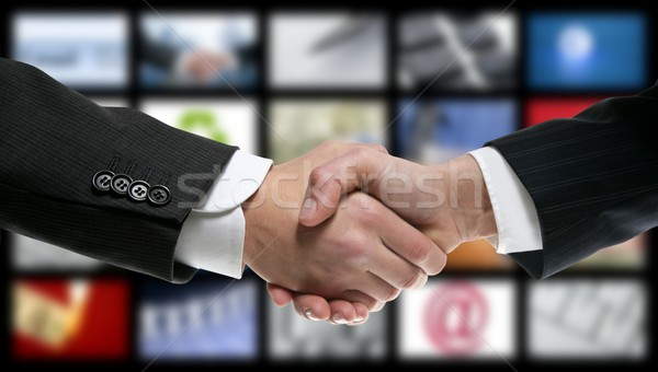 handshake over video tv screen technology Stock photo © lunamarina