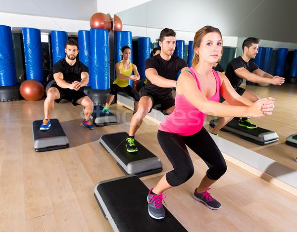 Cardio step dance squat group at fitness gym Stock photo © lunamarina
