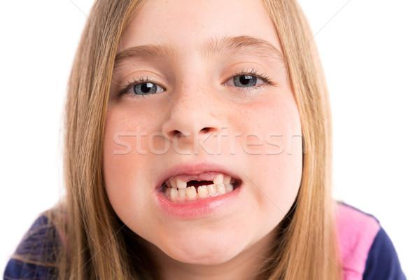 Blond indented girl showing teeth funny portrait Stock photo © lunamarina