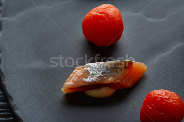 Bota sardine with osmotized tomatoes macro Stock photo © lunamarina