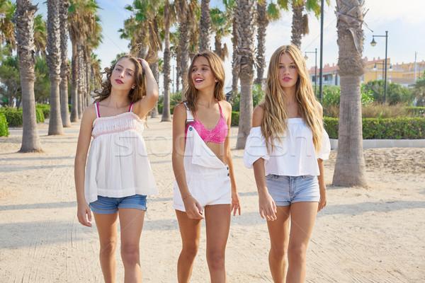 Stock photo: Teen best friends girls walking in palm trees
