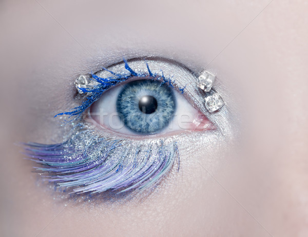 Blue eye macro closeup winter makeup jewels diamonds Stock photo © lunamarina