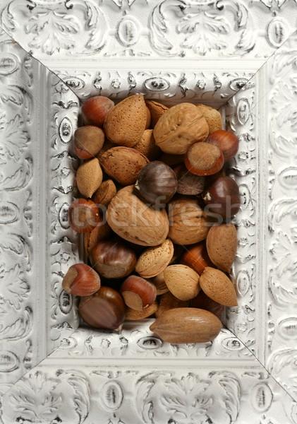 wooden decorated classic white frame, varied nuts Stock photo © lunamarina