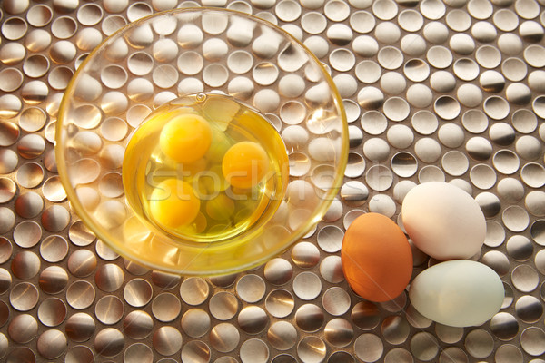 Eggs with blue easter white and brown egg colors Stock photo © lunamarina