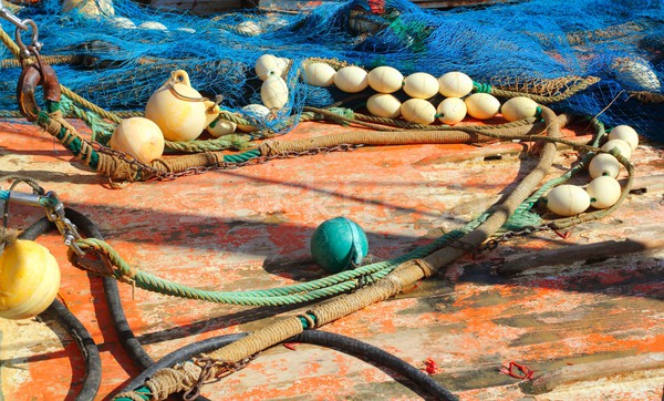 Fisherboat deck with net and tackle Stock photo © lunamarina
