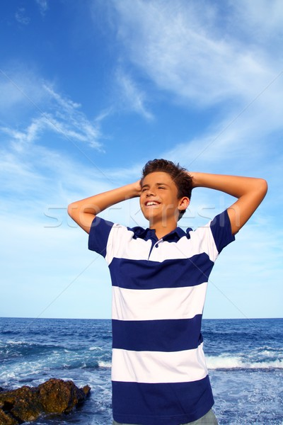 boy teenager hands in head relaxed in blue ocean Stock photo © lunamarina
