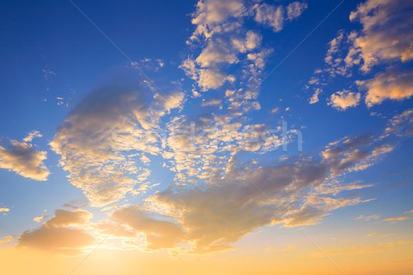 Sunset sky with golden and blue clouds Stock photo © lunamarina