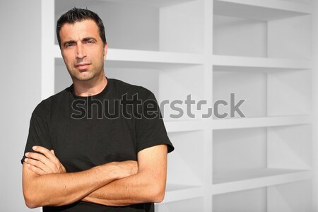 Stock photo: Medium age man interior house white shelves