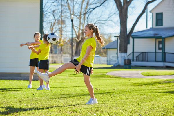 Barát lányok tinédzserek játszik futball futball Stock fotó © lunamarina