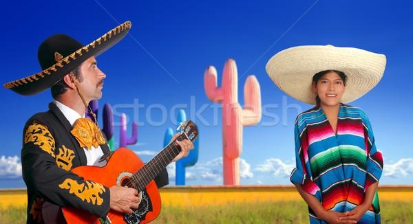 mariachi charro playing guitar mexican poncho girl Stock photo © lunamarina