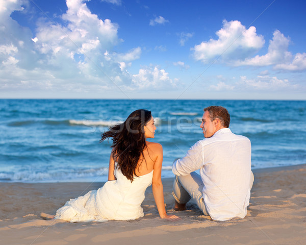 couple in love sitting in blue beach Stock photo © lunamarina