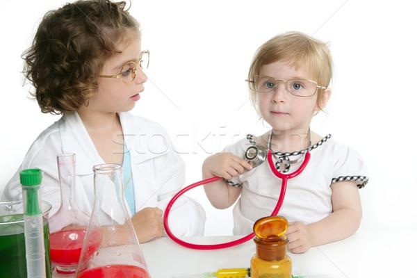 Girls pretending to be doctor in laboratory Stock photo © lunamarina