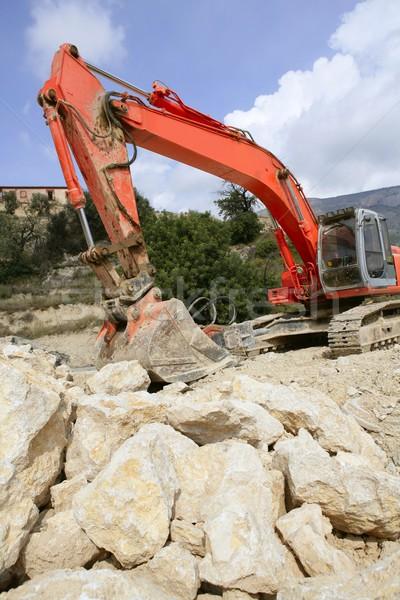 Backhoe bulldozer working hard with stones  Stock photo © lunamarina